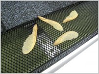 "More about the '6"" Black Drop In Leaf Guard-Small Hole' product"
